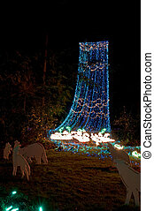 Waterfall in Christmas Lights - This outdoor nature scene at...