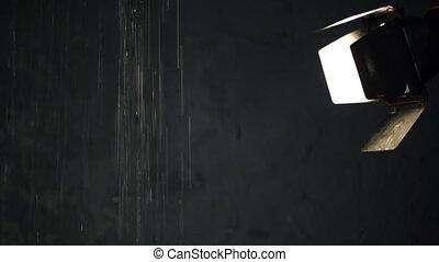 Waterfall in dark room with spotlight