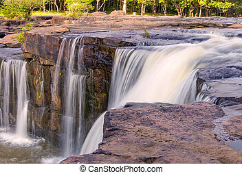 Waterfall in deep rain forest jungle. TadtonWaterfall...
