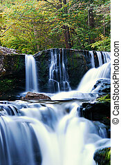 Waterfall in forest - Waterfall over rocks in mountain...