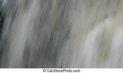 Waterfall in forest zoom out