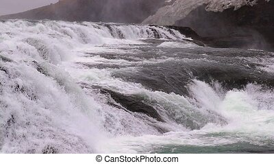 Gullfoss waterfall in Iceland, slow motion from 120 fps, water coming down with strong current