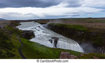 Waterfall in Iceland. Waterfall Gullfoss travel tourist attraction destination. Icelandic waterfalls, famous attraction on the Golden circle. AKA Golden Falls. Nature lansdcape in 4K UHD, 8K available