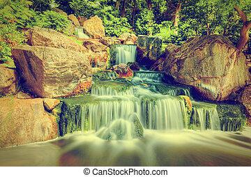 Waterfall in Japanese garden. Holland Park in London, UK.