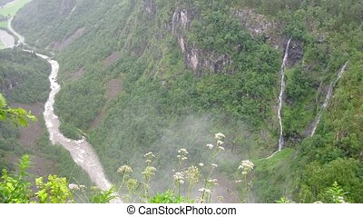 Waterfall in misty mountains near Stalheim, time lapse