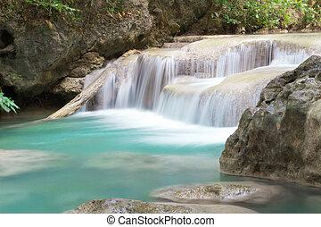 Waterfall in Erawan Nationalpark deep forest on mountain, Thailand