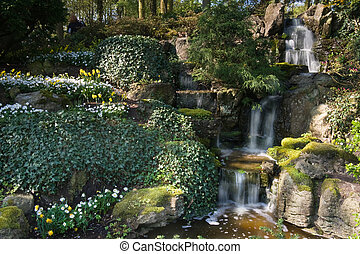 Waterfall in park in spring