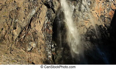 Waterfall in Pyrenees mountains.