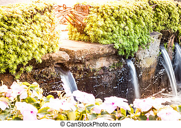 Waterfall in small size in the garden.