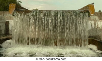 Waterfall in the city. Autumn daytime. Smooth dolly shot