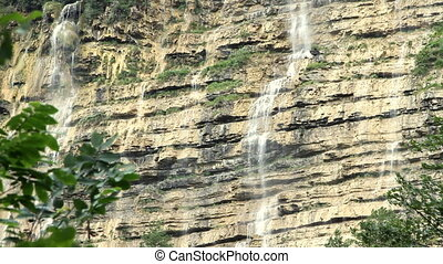Waterfall in the forest on summer day - Waterfall in the...