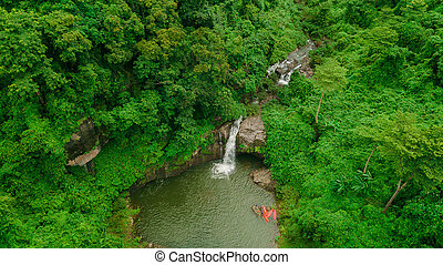 Waterfall in the middle of the forest. Bird eye view , drone