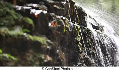 Waterfall in the mountains. Nature background with change focus and shift camera. HD. 1920x1080