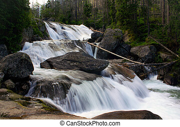 Waterfall in the mountains of the High Tatras in Slovakia