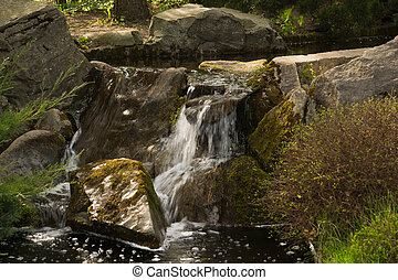 waterfall in the park at summer
