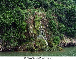 waterfall in the riverside mountain