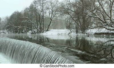 Waterfall in the winter park. Used professional gimbal...