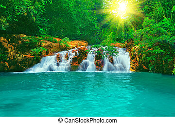 Waterfall in tropical forest at sunny day