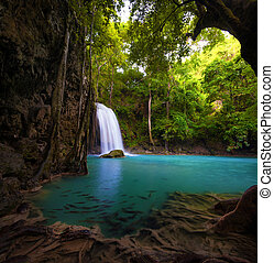Waterfall in tropical forest. Beautiful nature background