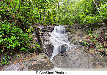 Waterfall in tropical rain forest jungle. Thailand beautiful nature