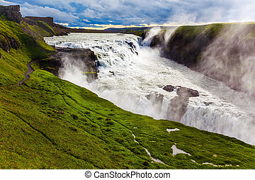 Waterfall in tundra - Gullfoss - Water fog fly up over...