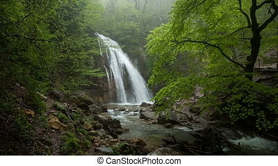 Waterfall Jur-Jur among green forest