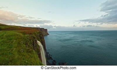 Waterfall Kilt Rock - water fall into the sea - Isle of...