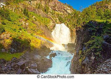 Waterfall Latefossen at sunset lights in summer, Norway