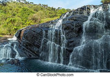 Waterfall mountain landscape Baker's Falls in Horton Plains National Park Sri Lanka.