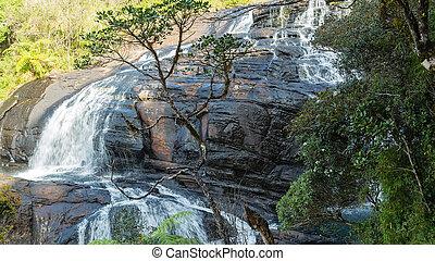Waterfall mountain landscape Bakers Falls in Horton Plains National Park Sri Lanka.