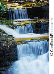 waterfall mountain - Waterfall in mountain with rocks