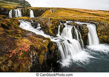 Waterfall near Kirkjufell, natural landmark of Iceland
