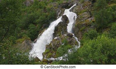 Waterfall of landscape scenery in mountains - Waterfall...