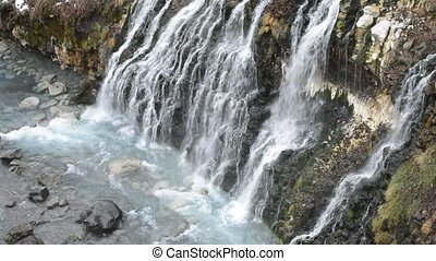 Waterfall on a slope - Streaky waterfall flowing on a slope...