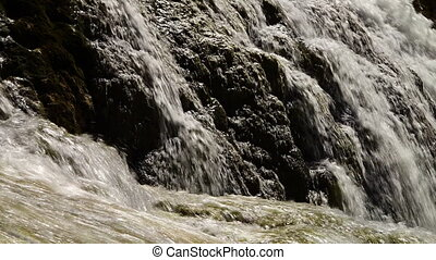 Waterfall on a very abrupt rock - A steady, medium shot of a...