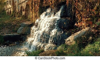 Waterfall on the Ruins in the Autumn