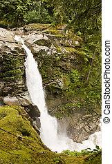 Waterfall Over Mossy Rocks