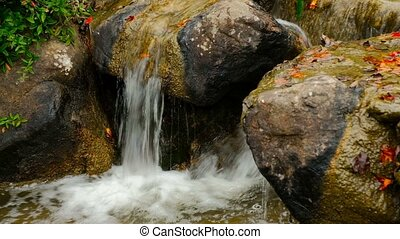 Waterfall Over The Boulders. Fast whitewater stream.