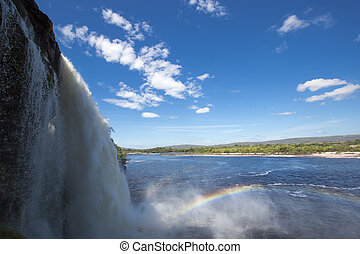 Waterfall, rainbow and Canaima Lagoon, Venezuela