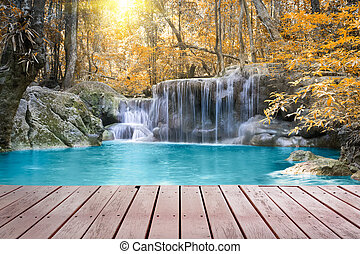 Scenery of Waterfall with wood deck.