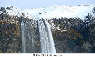 Waterfall Seljalandsfoss in Iceland in spring