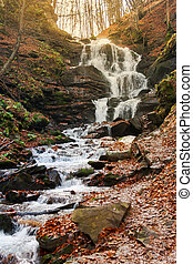 waterfall Shypot of Carpathian mountains in autumn. powerful...
