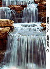 Waterfall - Beautiful cascading waterfall over natural...