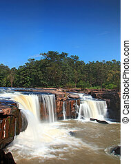 waterfall Tadtone in climate forest of Thailand top perspective, vertical