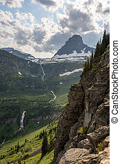 Waterfall Tumbles out of Logan Pass into Valley