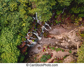 Waterfall with clear water in tropical forest. Aerial view