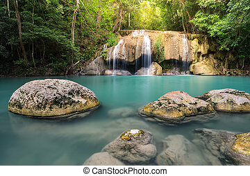 Waterfall with stones and green water