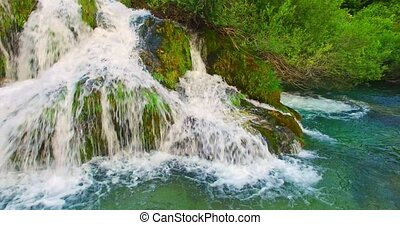 Waterfall with turquoise water - Waterfall with white foamed...