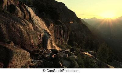 Waterfalls at Sunrise - Mountain waterfalls at sunrise in...