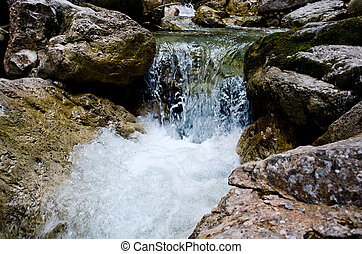 Waterfalls at the Neuschwanstein castle, Bavaria Germany.